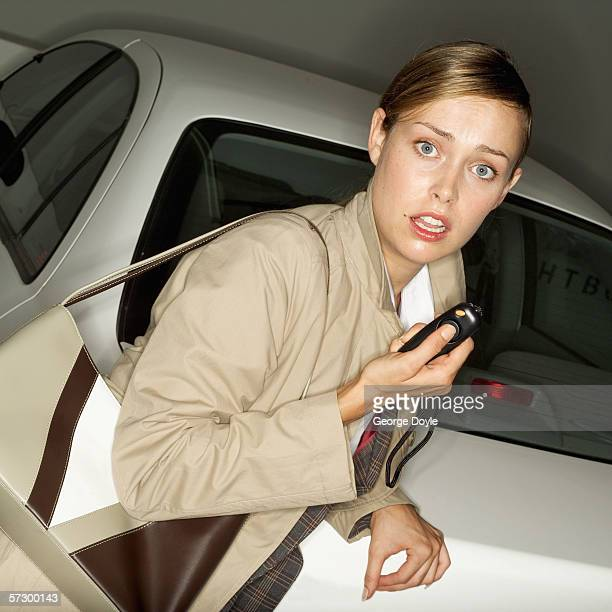 young woman looking at camera holding a pepper spray - pepper spray stock pictures, royalty-free photos & images