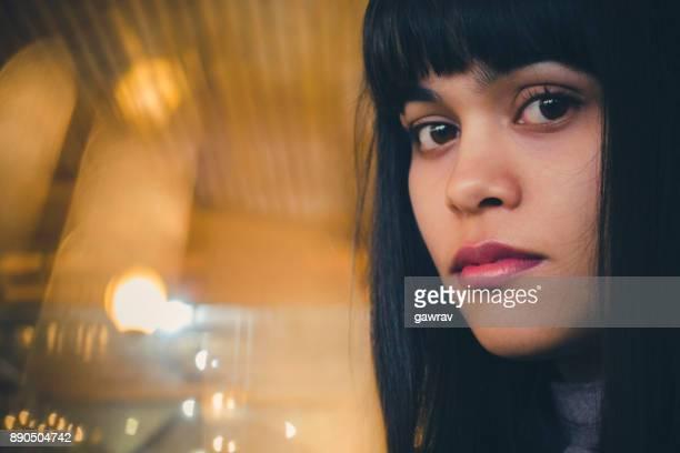 Young woman looking at camera.