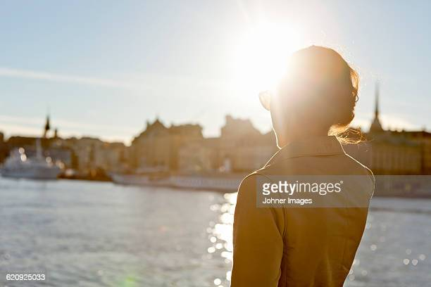 Young woman looking at city view