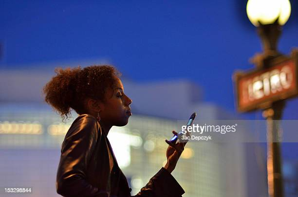 young woman looking at her mobile, paris - depczyk stock pictures, royalty-free photos & images