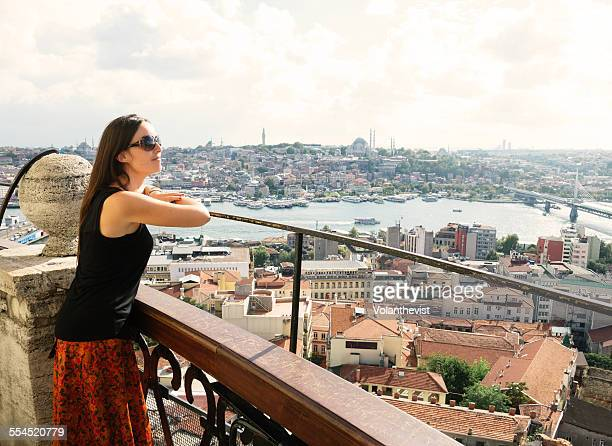 Young woman looking at Istanbul from Galata tower