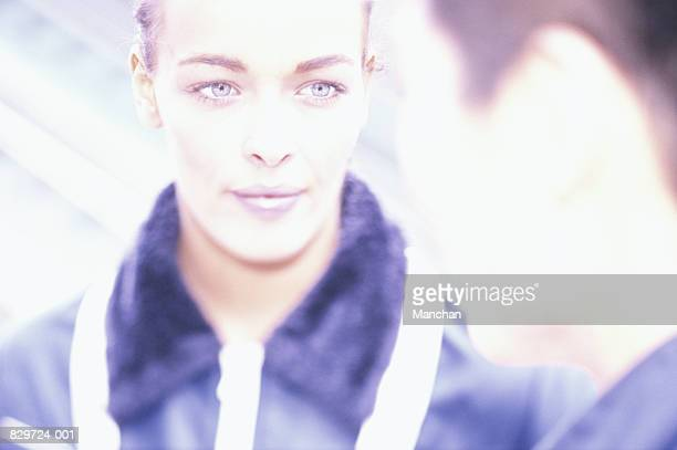 Young woman looking at man (focus on woman), close-up
