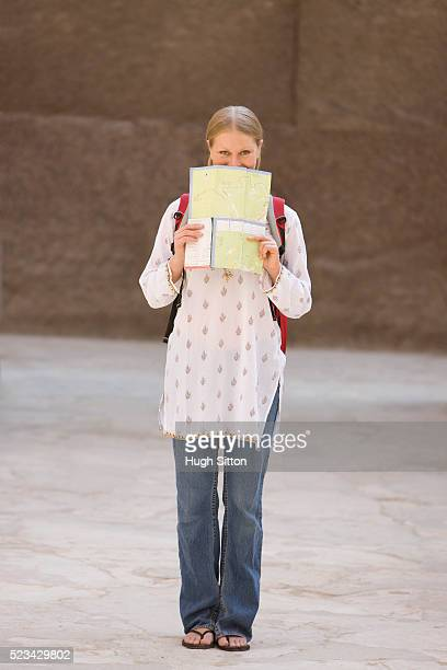 young woman looking at map - hugh sitton stock pictures, royalty-free photos & images