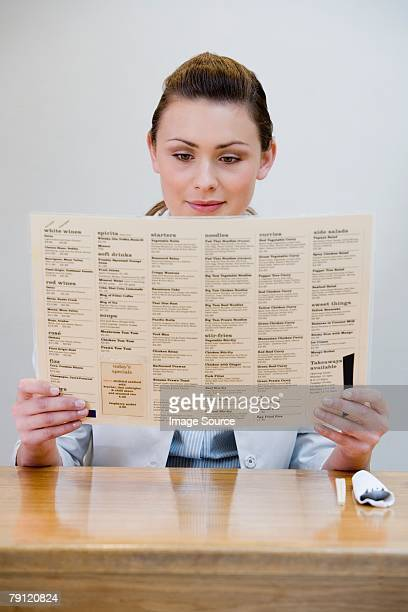 Young woman looking at menu