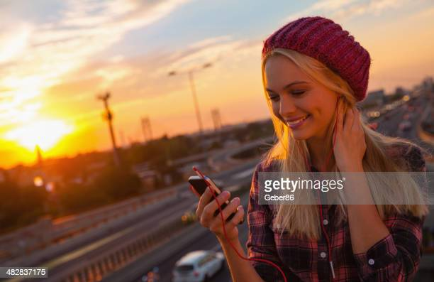 Young woman looking at mobile phone