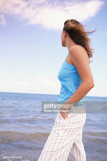 Young woman looking at ocean, side view