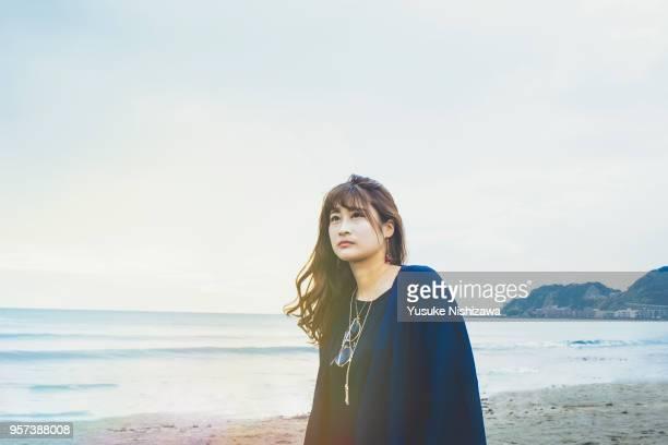 a young  woman looking at one point - yusuke nishizawa bildbanksfoton och bilder