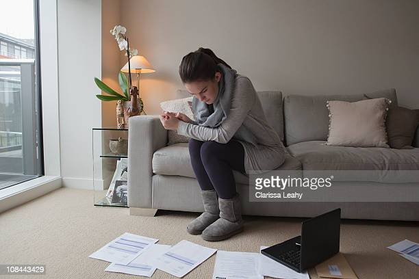 Young woman looking at paperwork