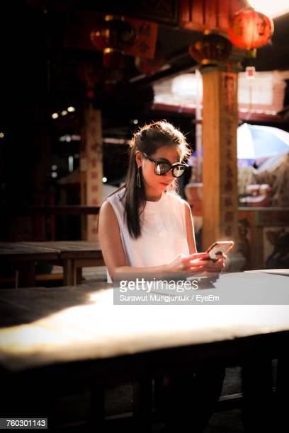 Young Woman Looking At Phone