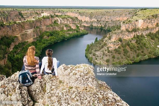 young woman looking at river in canyon - marco cristofori fotografías e imágenes de stock