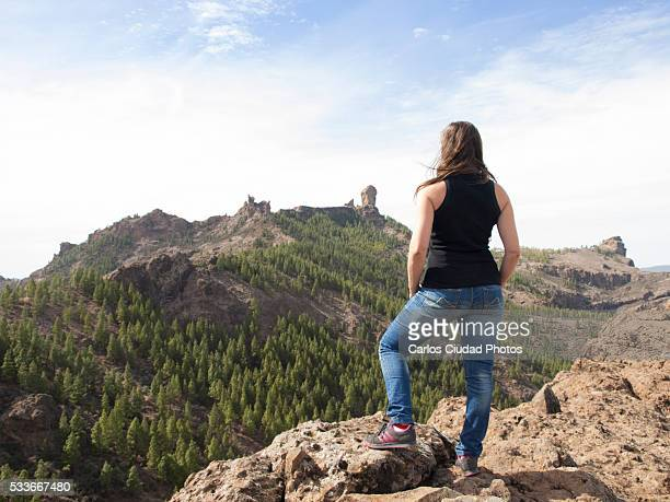 young woman looking at roque nublo - tejeda canary islands stock pictures, royalty-free photos & images