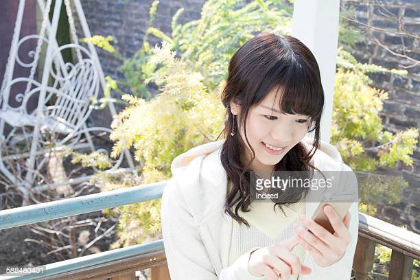 Young woman looking at smart phone