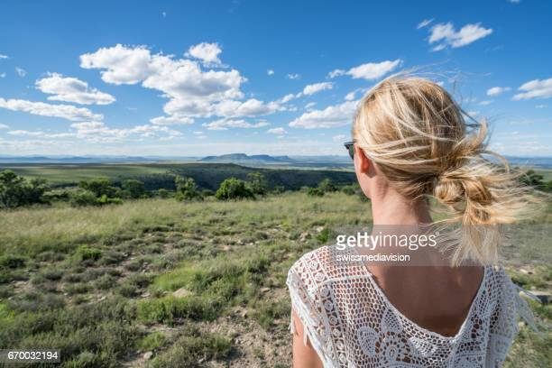 Young woman looking at spectacular mountain scenery