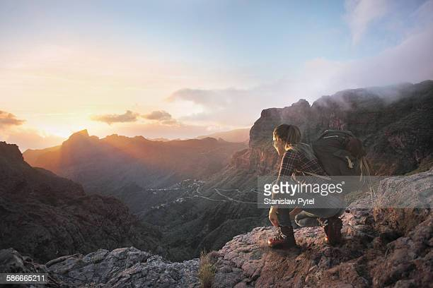 Young woman looking at sunset in mountains