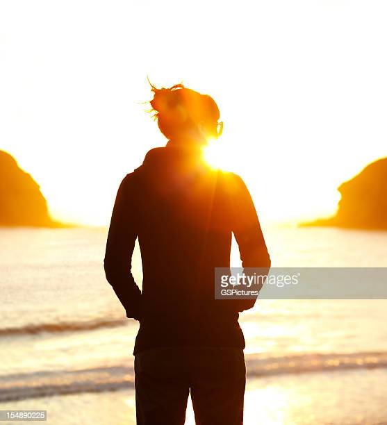 Young woman looking at sunset