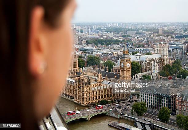 Young woman looking at the Big Ben, London (United Kingdom)