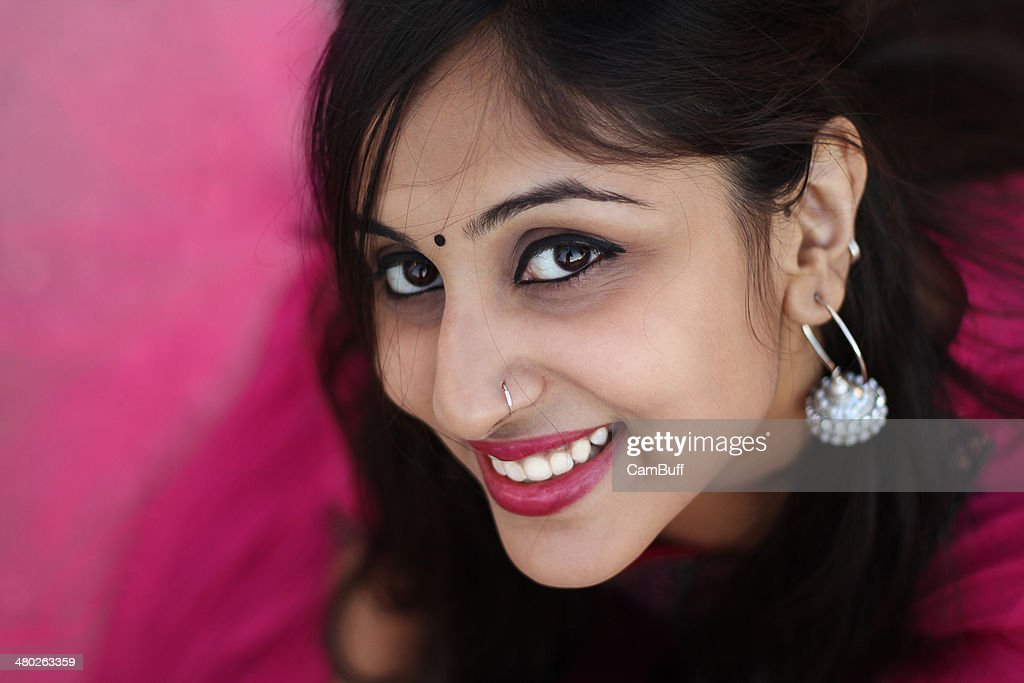 Young woman looking at the camera : Stock Photo