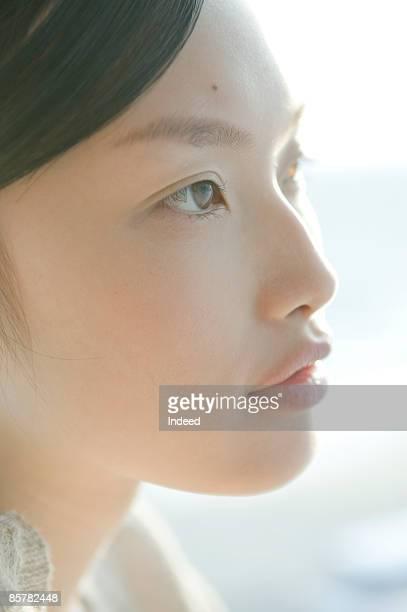 Young woman looking at view, close up