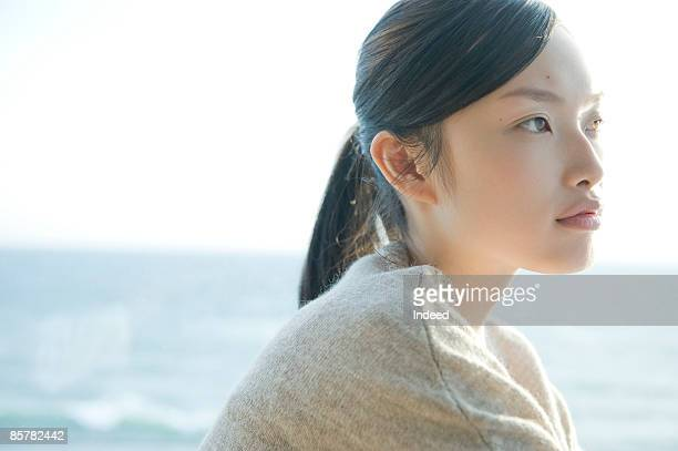 Young woman looking at view, portrait