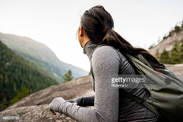Young woman looking at view, Squamish, British Columbia, Canada