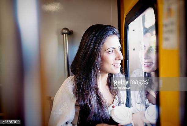 Young woman looking at window in subway train