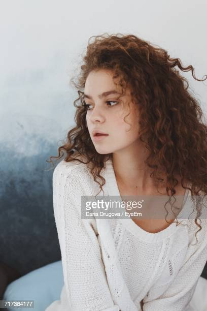 Young Woman Looking Away Against Clear Sky