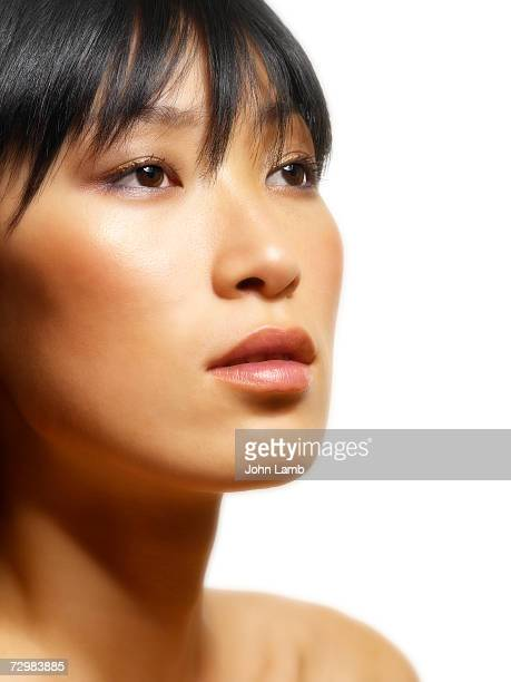 young woman looking away, close-up - one young woman only stock pictures, royalty-free photos & images