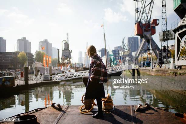 young woman looking away on the pier in rotterdam - rotterdam stock pictures, royalty-free photos & images