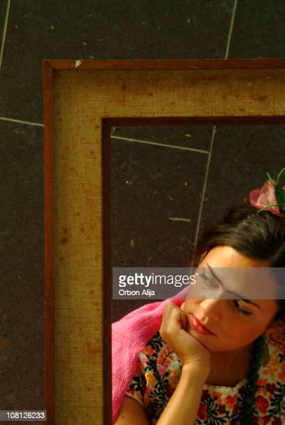 Young Woman Looking Away with Picture Frame Around Her
