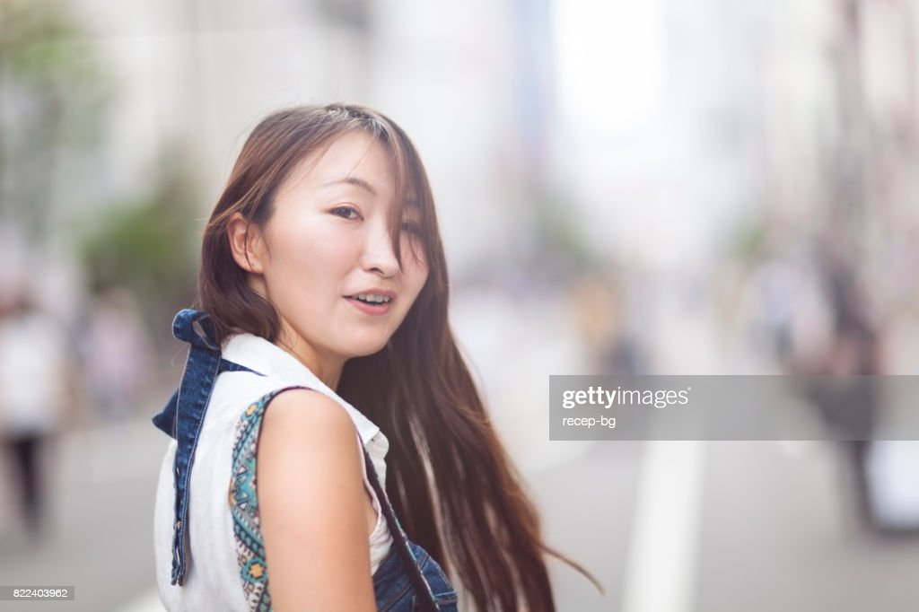 Young Woman Looking Back : Stock Photo