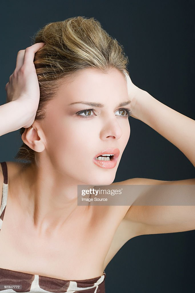 Young woman looking confused : Stock Photo