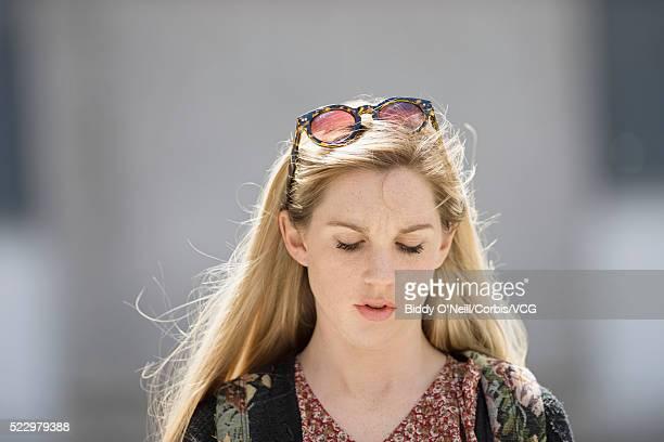 young woman looking down - down blouse stockfoto's en -beelden