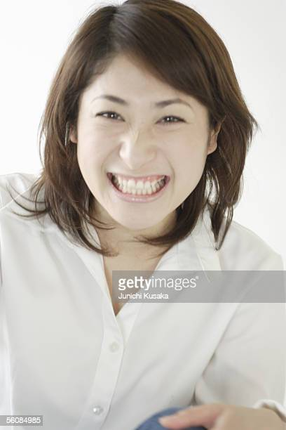 a young woman looking down - down blouse stock pictures, royalty-free photos & images