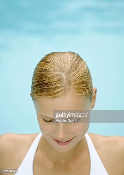 young woman looking down - hair parting stock photos and pictures