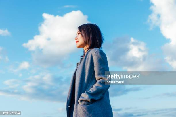 young woman looking forward to the future - looking stock pictures, royalty-free photos & images