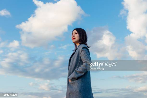 young woman looking forward to the future - business person stock pictures, royalty-free photos & images