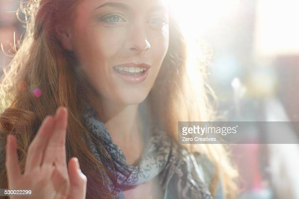 young woman looking in shop window - staring stock photos and pictures