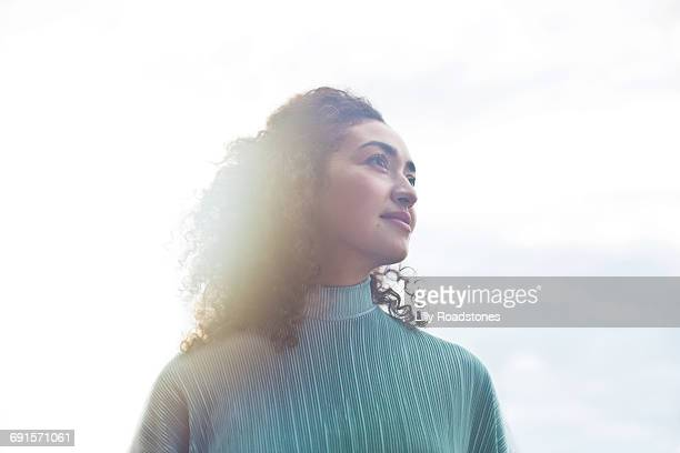 young woman looking into distance - hope stock pictures, royalty-free photos & images