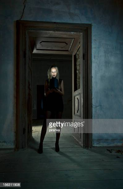 young woman looking into magic box - magic doors stock pictures, royalty-free photos & images