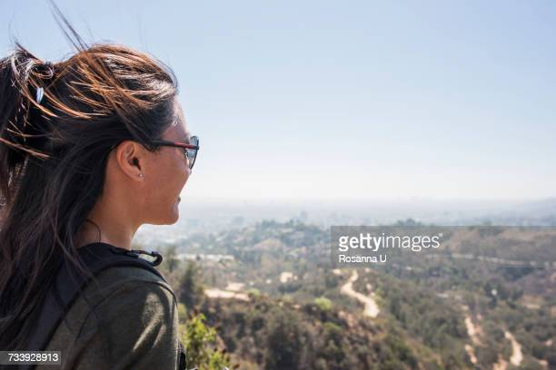 young woman looking out at landscape from hollywood sign, los angeles, california, usa - hollywood hills stock pictures, royalty-free photos & images