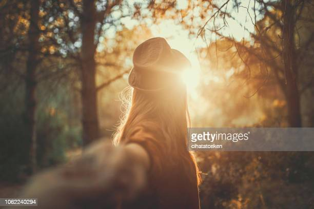 young woman looking out at the forest at sunrise, after me - sunrise contemplation stock pictures, royalty-free photos & images