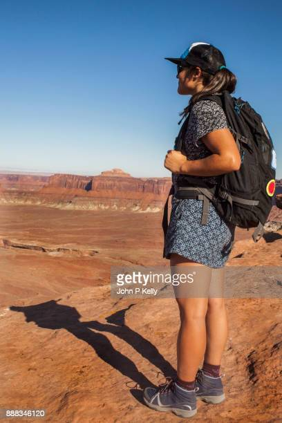 Young woman looking out at the Green River in Canyonlands National Park