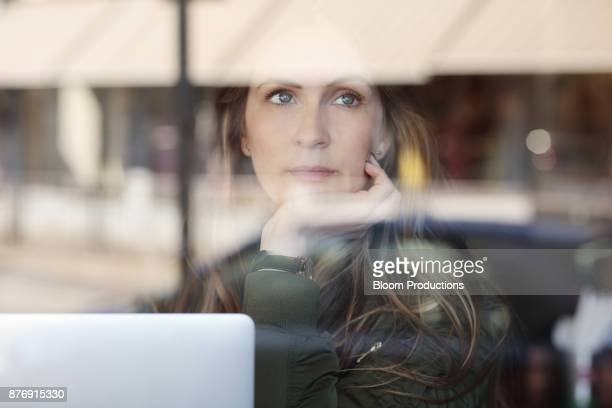 Young woman looking out of a window
