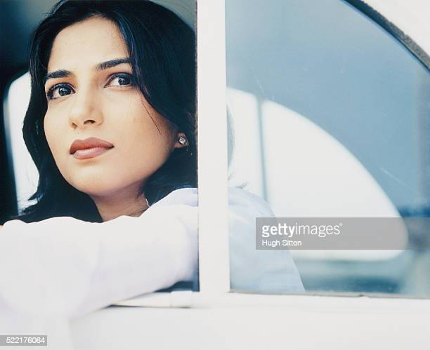 young woman looking out of car - hugh sitton stock pictures, royalty-free photos & images