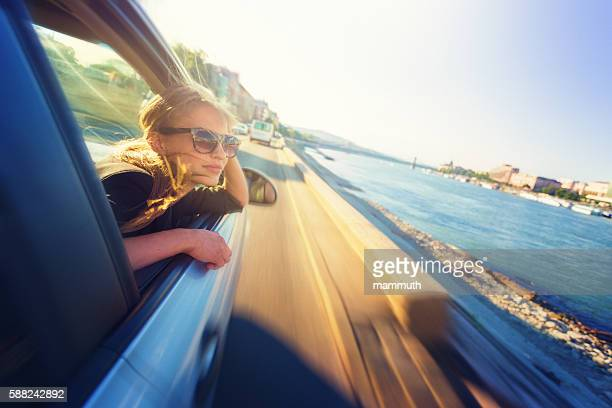 Young woman looking out of the car window