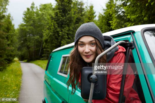 young woman looking out the car window. - red jacket stock pictures, royalty-free photos & images