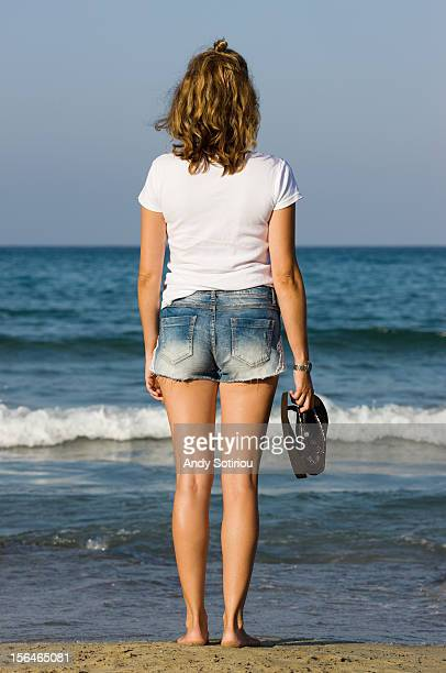young woman looking out to sea - la manga stock pictures, royalty-free photos & images