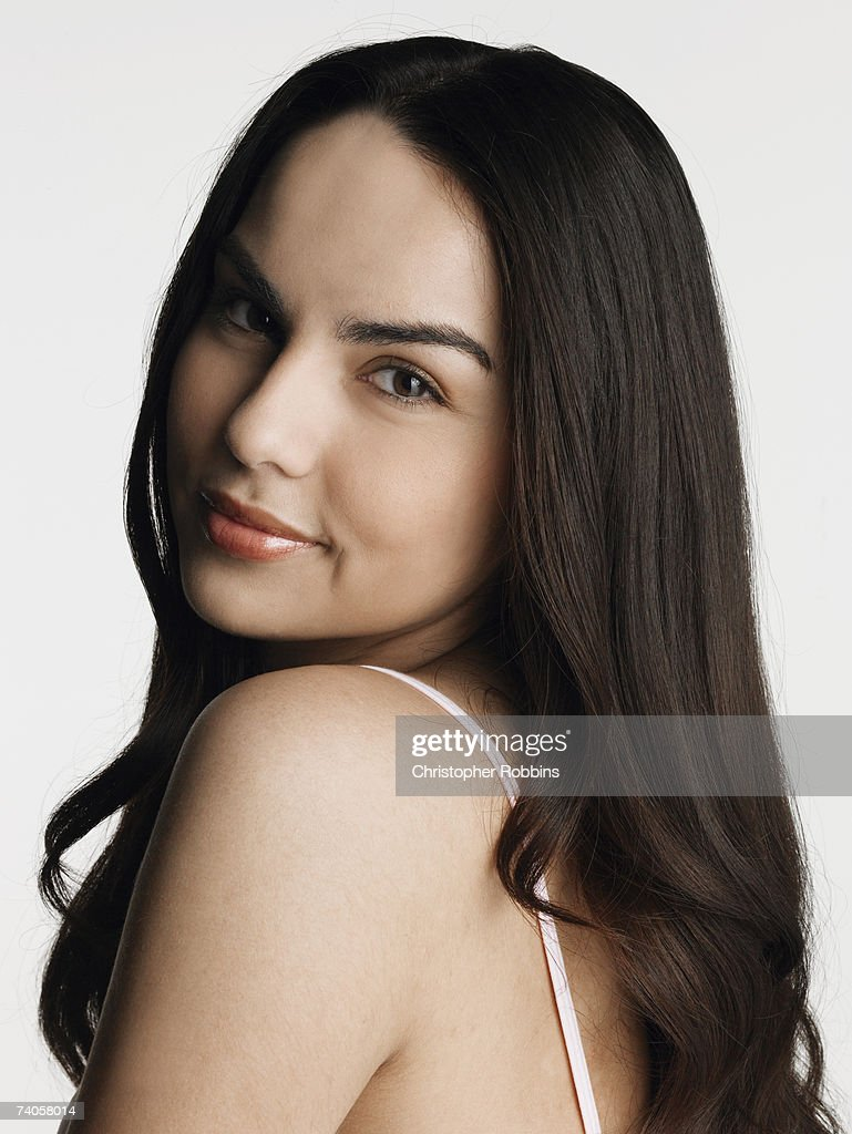 Portrait young woman looking over naked shoulder ⬇ Stock