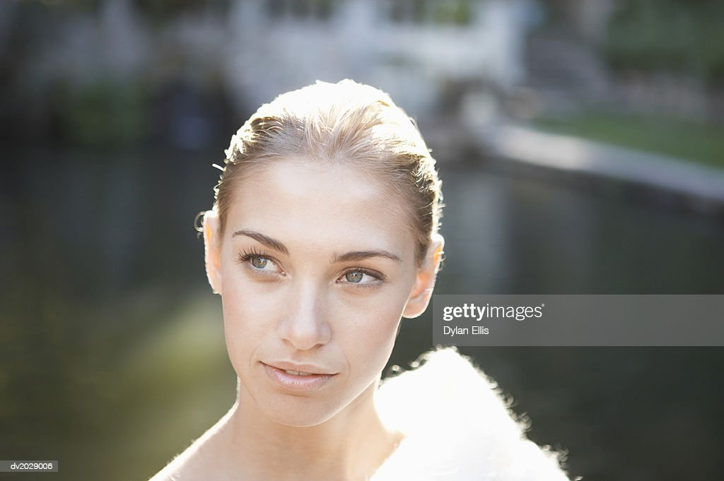 Young Woman Looking Sideways and Wearing a Woolen Shawl : Stock Photo