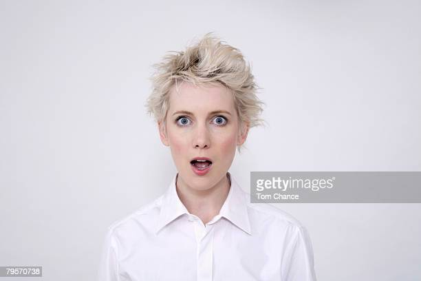 young woman looking surprised, portrait - surprise stock pictures, royalty-free photos & images